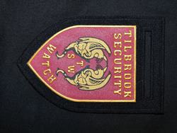 Badge with embossed logo