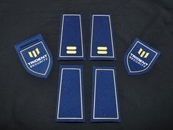 Embossed badges and epaulets